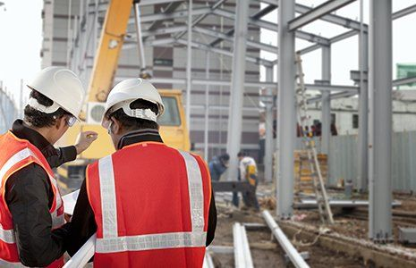Two workers discussion on construction site