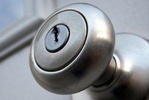 Close up of a door knob with a keyhole in it