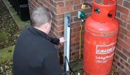 gas boiler being checked