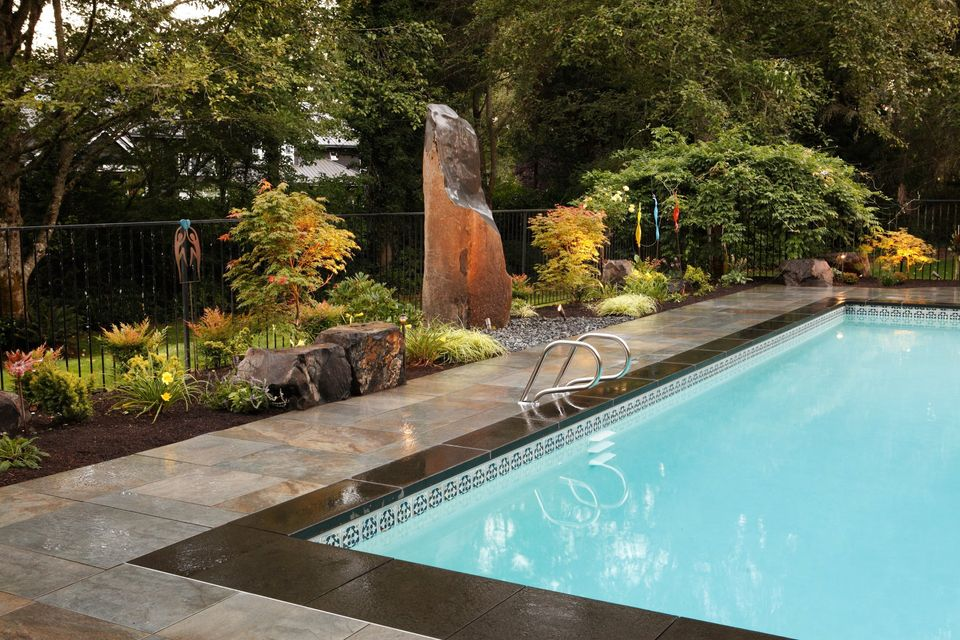 outdoor pool columnar water feature and maple trees