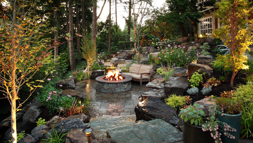 Fireplace and patio with greenery