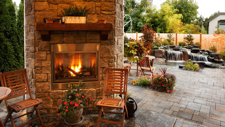 fire place and water feature in backyard