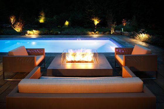 pool side fireplace backyard