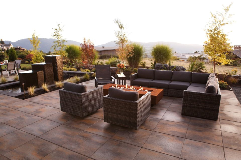 outdoor backyard resort patio paver fireplace
