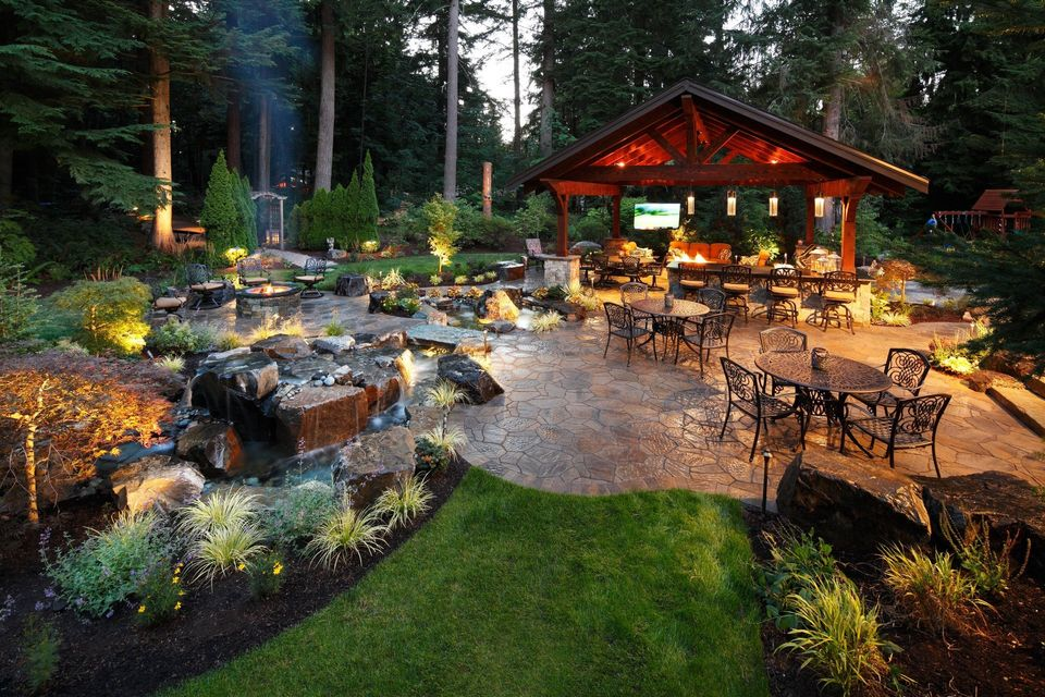 Redmond resort with large paver patio and outdoor structure