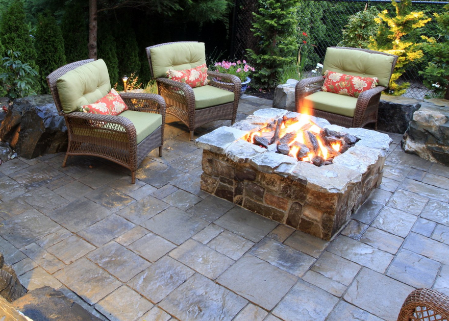 stone fire pit backyard structure and plantings