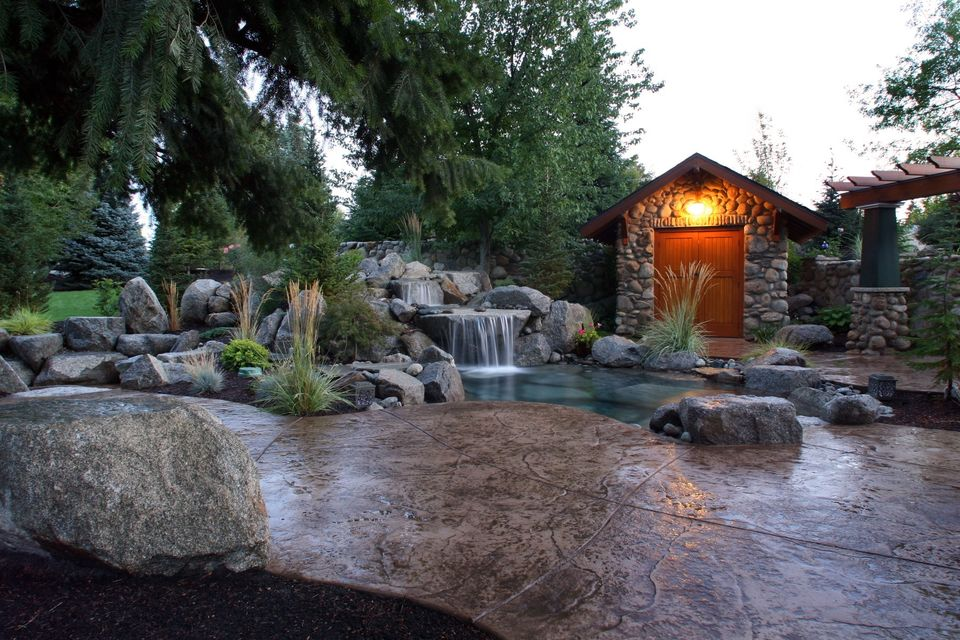 backyard resort water feature and pavers