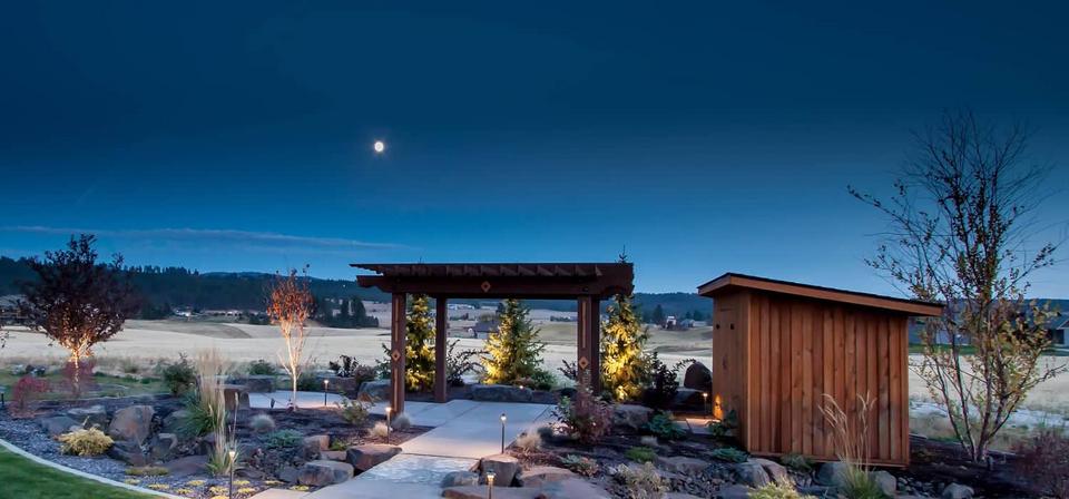 night time garden patio pergola shed