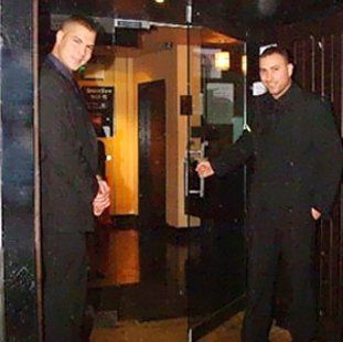 two male door staff