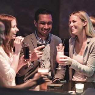 man and two women drinking