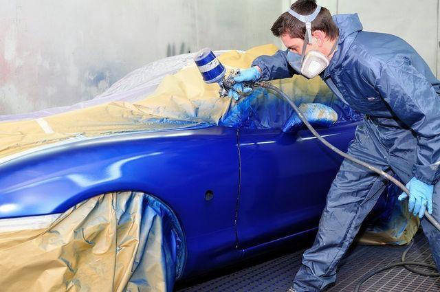 Auto Body Paint technician applying paint in shop in Buffalo, NY
