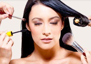 applying beauty treatments to female model