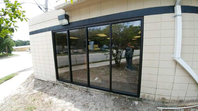 Commercial glass installation jacksonville fl storefront door repair image of commercial glass windows on a store in jacksonville fl planetlyrics Gallery