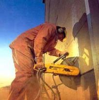 hardcut concrete sawing and drilling worker handling electronic sawing equipment