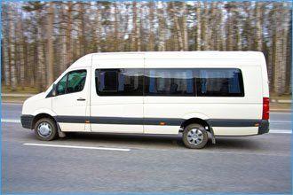 white long wheelbase minibus