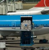 Air freight - good being loaded onto a plane