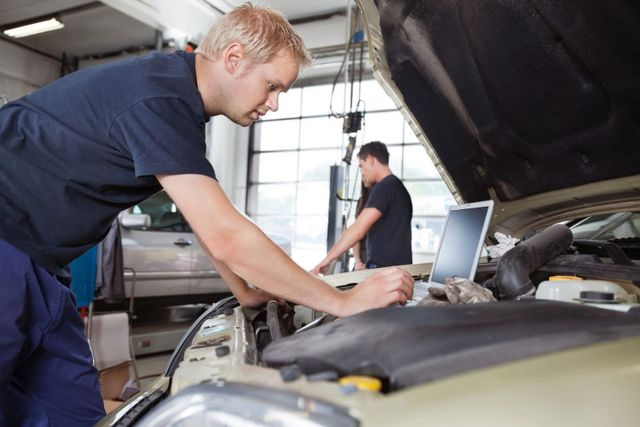 Mechanic working on power steering on South Island