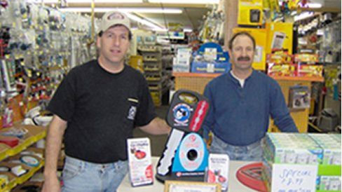 Employee with hardware supplies in Rochester, NY