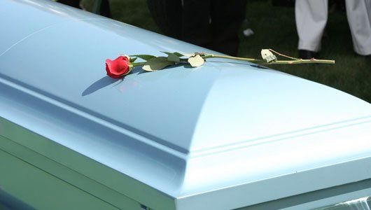 rose on coffin