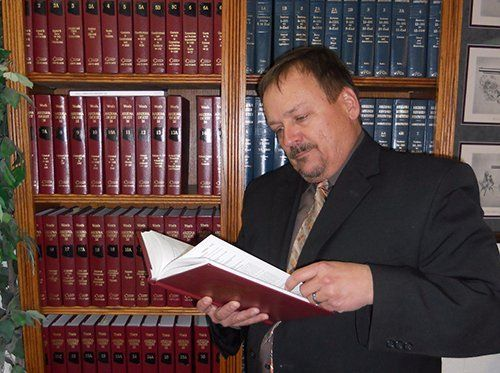 Professional referring to the legal books