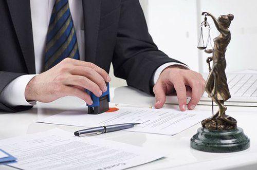 A criminal defense attorney doing paperwork in th Kingman, AZ, area