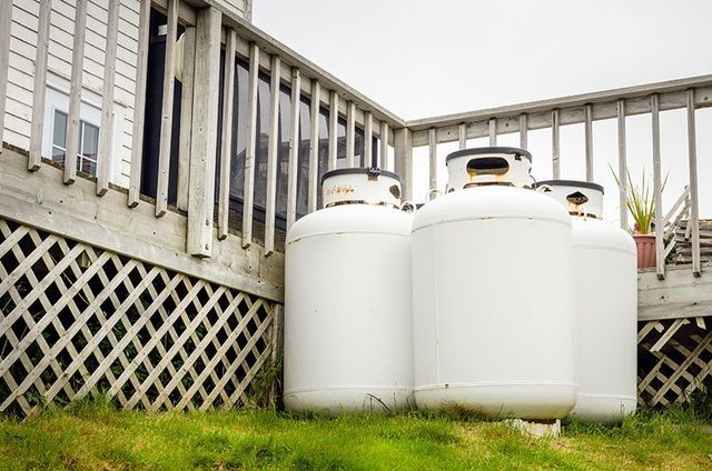 Propane cylinders in the backyard of house in Superior