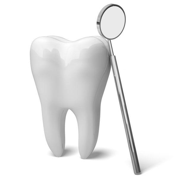 dente e specchietto dentistico