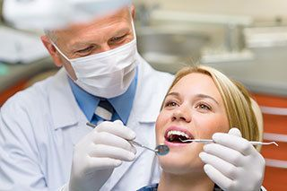 Dentist and patient in Oscar N Guerra DDS in Ashland