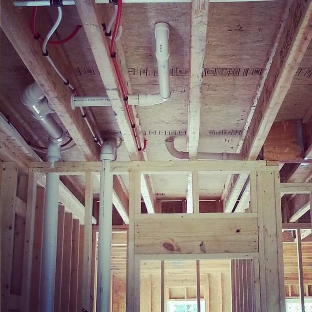Man installing residential and commercial plumbing fixtures in Thomasville, NC