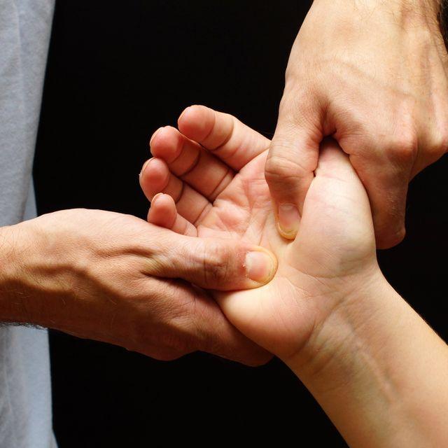 A man massaging a hand