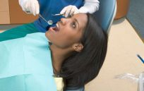 A woman experiencing dental treatments in Anchorage, AK