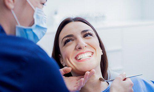 Beautiful girl smiling at dental clinic