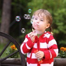 girl playing with air bubble