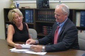 Attorney Scott Dunn consulting with a client in Asheboro, NC