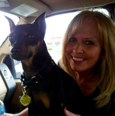 Smiling Woman With Her Dog — Home Restoration in Westerville, OH