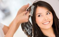 Woman gets her hair washed for one of our professional hair styles in Canyon Lake, TX