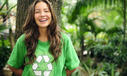 A girl promoting green rubbish collection in Matamata