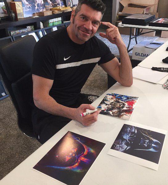 Spencer Wilding Signing Wooden Darth Vader 8X10 Print
