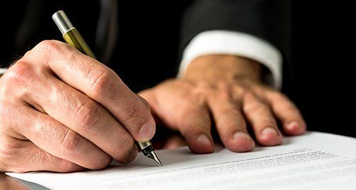 Client signing bail bond documents in Texarkana, TX