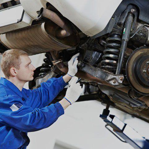 Mechanic checking the car