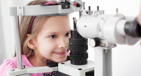 child getting her eye checked