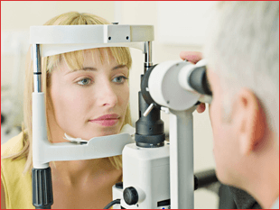 Optician testing his patient's eyes
