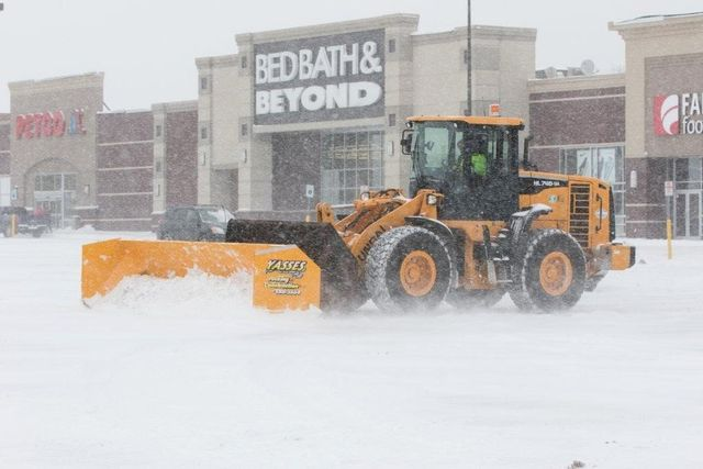 Snow removal for a store plaza in Batavia, NY
