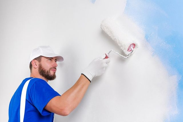 man painting wall