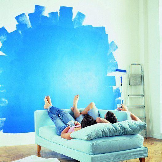 man and woman looking at painted wall