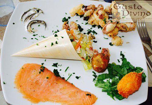 Piatto di pesce Ristorante Pizzeria Gusto Divino di Giovanni Grado a Montallegro
