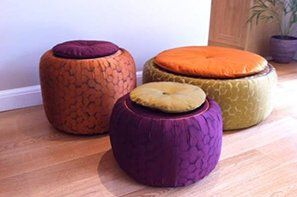 Three round footstools in bright colours