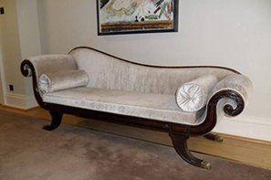 A coffee coloured velvet chaise longue