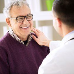Smiling happy old patient visit doctor