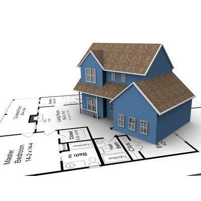 Un modellino di una casa blu sul disegno di un progetto edile